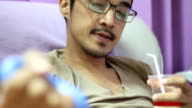 young man squeezes the ball in his hand during Single donor platelets blood