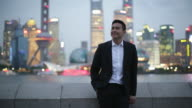 WS Young man standing on The Bund, Shanghai, China