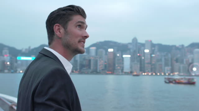 MS RV Young man travelling on a boat in Hong Kong