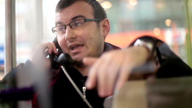 Young man using Subway phone