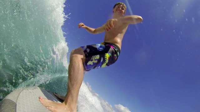 Young man wave surfing