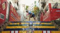 WS A young man wearing an Argentina t-shirt practices football skills on Selaron Steps (Escadaria Selaron) / Rio de Janeiro, Brazil
