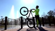 Young man wit bike exercise in the park
