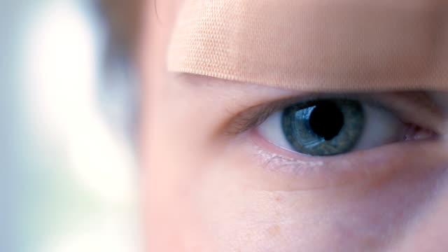 Young Man with Bandaid over Eye