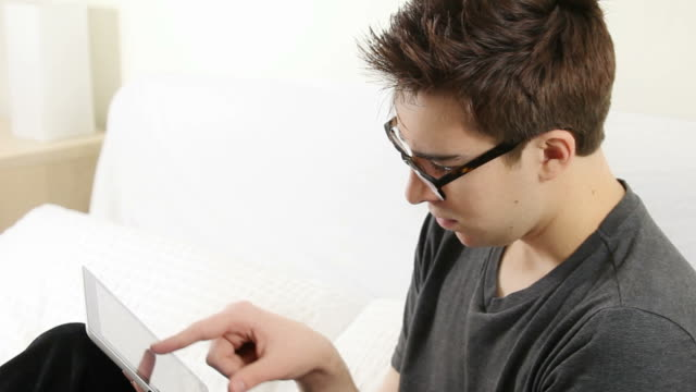 Young man with digital tablet.