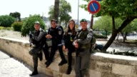 Young men and women from the Israeli Defense Forces and Police guard the old city of Jerusalem