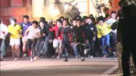 Young men race through the gate of Nishinomiya Shrine during the Toka-Ebisu festival Hyogo, Japan.