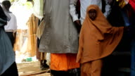 Young Muslim girl walking in the street on August 01 2011 in Dadaab Kenya