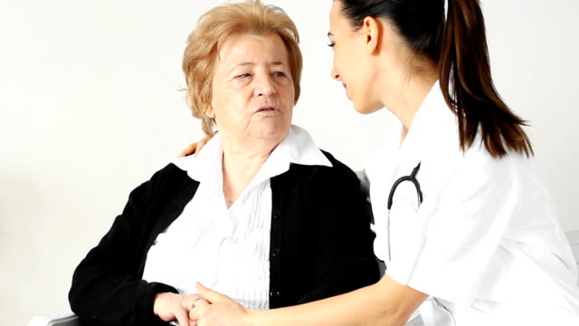 Young  nurse with her senior female patient.