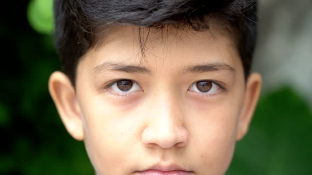 Young people and emotions, portrait of serious kid looking at camera