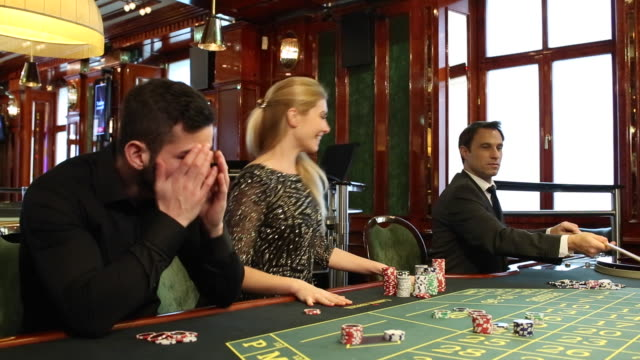 Young people gambling in a casino in Vienna.
