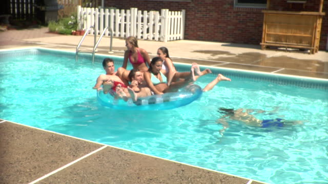 MS, Young people playing in swimming pool, Middlesex, New Jersey, USA
