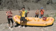 Young people preparing for white water rafting