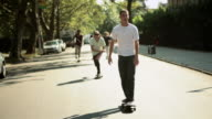 Young people skateboarding in street