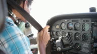 Young pilot in cockpit preparing to fly private airplane