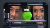 4K: Young professionals watching a 3D printer