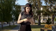 Young punk woman using a phone