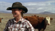 CU ZO Young rancher working with her cattle / Marfa, Texas, USA