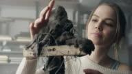 Young sculptor creates a clay sculpture