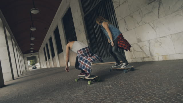 Young skater riding longboard skateboards