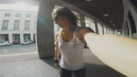 Young skater woman take a selfie video while riding