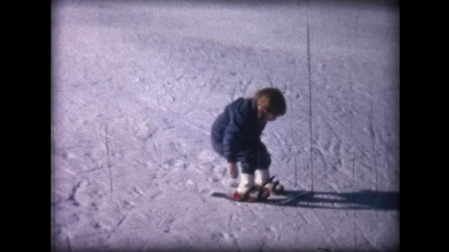 1963 young skier on tiny skis falls on her bottom