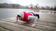 Young sportsman doing pushups