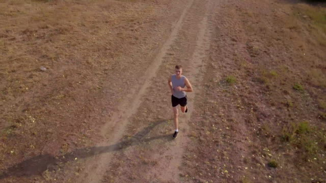 Young sportsmen running, aerial view