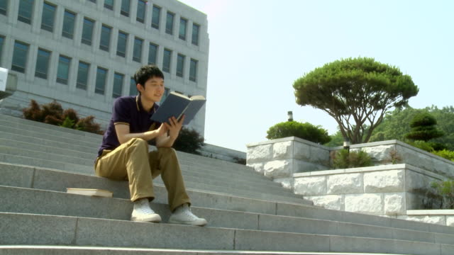 MS ZI Young Student reading book on college campus / Daejeon, Chungcheongbukdo, South Korea