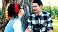 Young sweethearts flirting while they have picnic