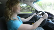 Young teenage girl age 16 with Dad in passanger seat as she drives car for the first time MR model released
