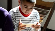 Young Teenager Playing Game On Smartphone