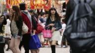 LS Young, trendy shoppers in Takeshita Dori, Harajuku District / Tokyo, Japan