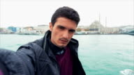 Young Turkish Man Taking Selfies Near Galata Bridge