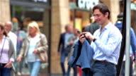 Young urban entrepreneur texting