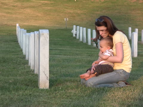 Young woman and son visit grave NTSC