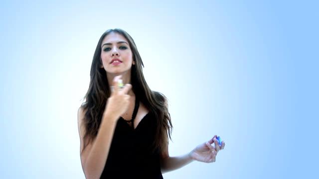 Young Woman applying perfume
