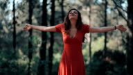 Young woman arms raised enjoying nature