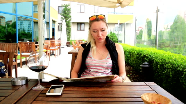 Young Woman at Cafe with menu