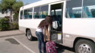 MS POV Young woman boarding bus