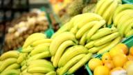 Young woman buying bananas