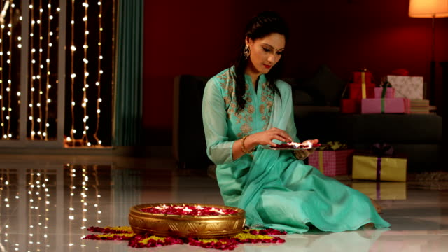 Young woman celebrating diwali festival, Delhi, India