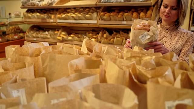 Young woman choosing bakery products