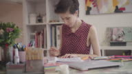 4K: Young Woman Coloring Book In Her Office.