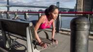 Young Woman Doing Pushups on Bench