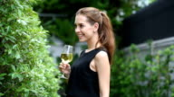 Young woman drink wine in garden ,her feeling happiness