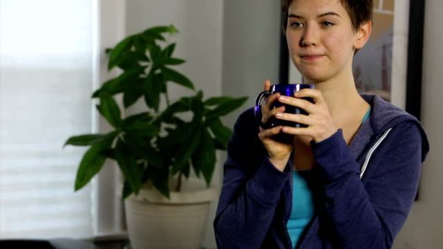 Young Woman Drinking Tea Portrait