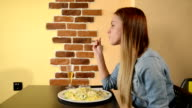 Young woman enjoy italian food