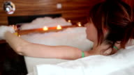 Young woman enjoying Jacuzzi in hotel room