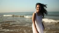 Young woman enjoying on the beach